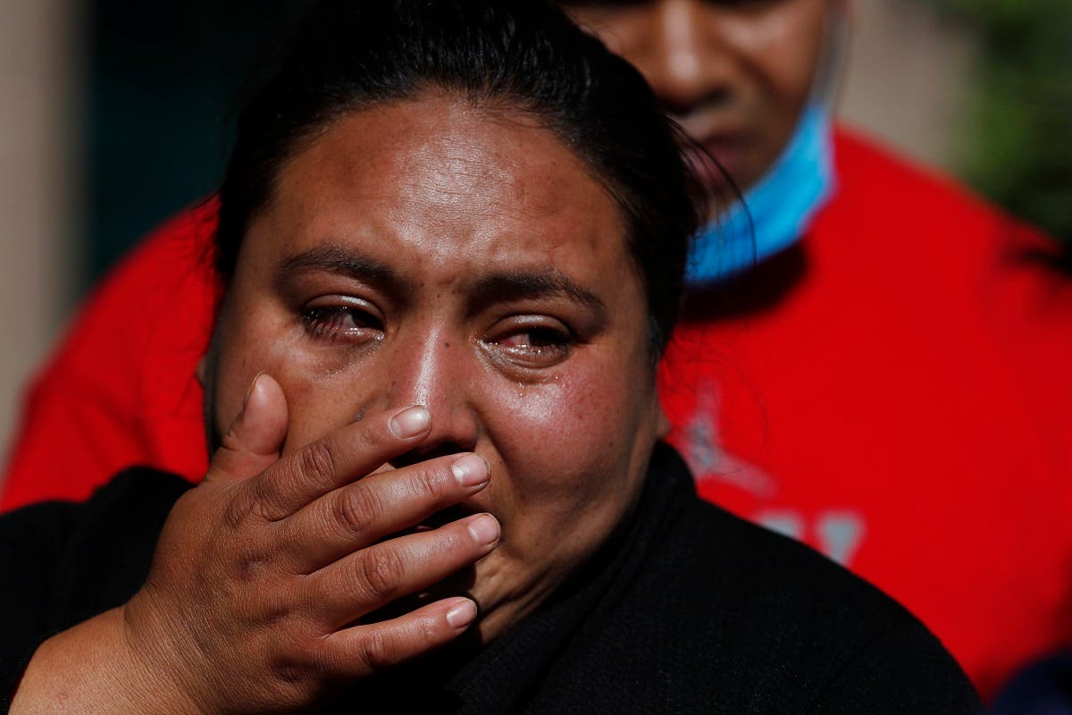 Gabriela Gomez cries after her sister Rosa Gomez, a street vendor, was killed at the scene where security secretary, Omar García Harfuch, was attacked by gunmen in Mexico City, on June 26, 2020. (AP)