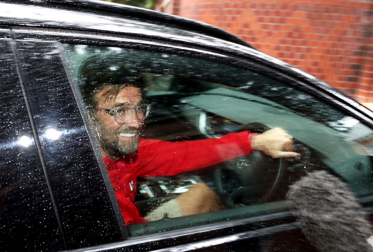 Liverpool manager Jurgen Klopp arrives at his home in Formby, Liverpool, England, on June 26, 2020. Liverpool clinched its first league title since 1990 on Thursday, ending an agonizing title drought. (AP)