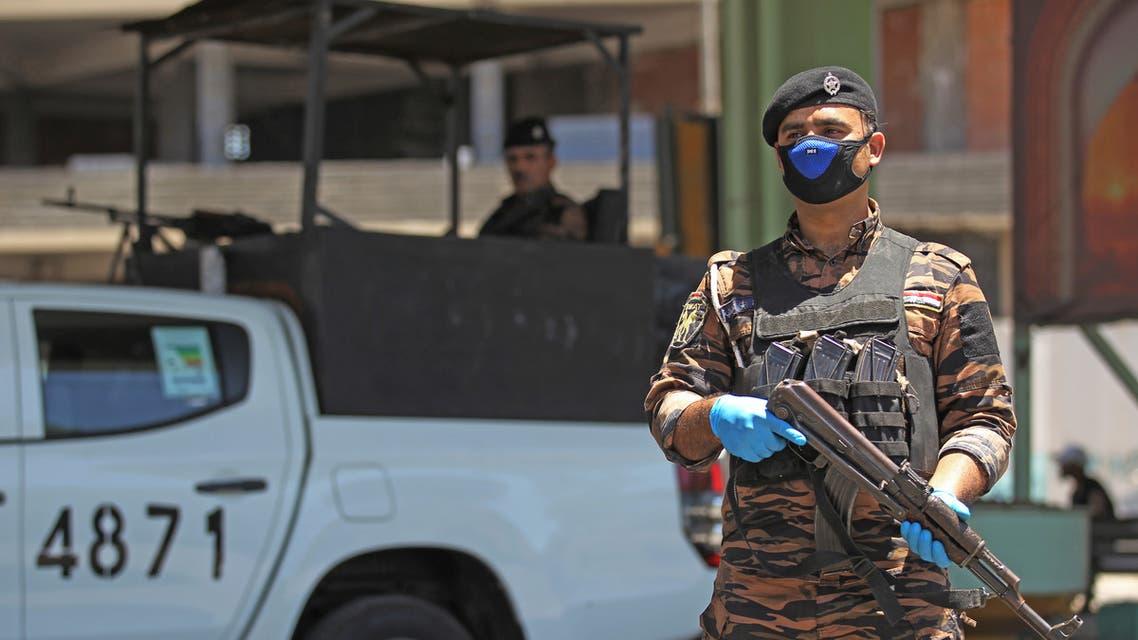 عنصر من القوى الأمنية العراقية (أرشيفية- فرانس برس)