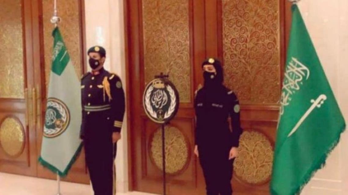 A Saudi female Royal Guard stands beside her colleague in an undated photo. (Twitter)