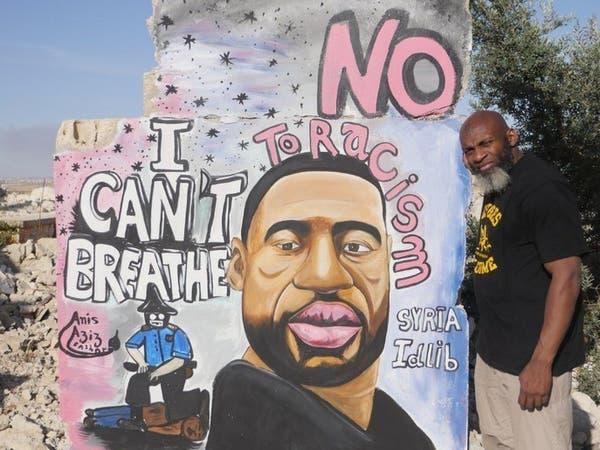 أميركي قاعدي من أصول إفريقيةيدعو من إدلب للإطاحة بترمب