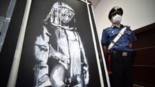 France arrests six over stolen Banksy artwork