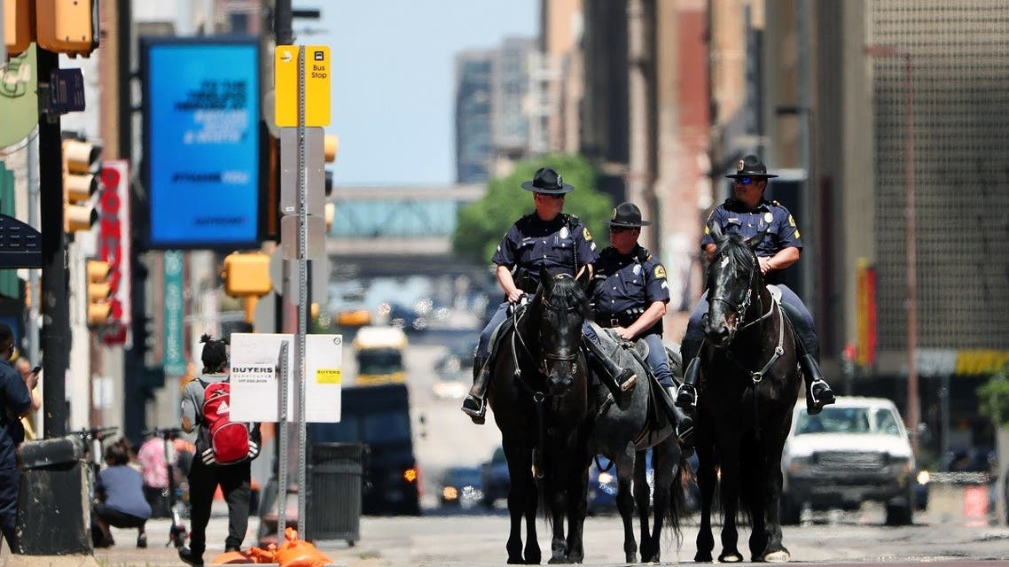 Dallas Police Department officers patrol through downtown Dallas in horseback on May 01, 2020 in Dallas, Texas. (AFP)