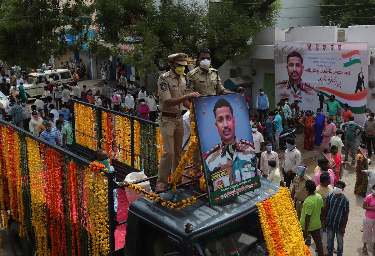 Indians participate in a funeral procession of Indian army officer Colonel B. Santosh Babu in Suryapet, about 140 kilometers (87.5miles) from Hyderabad, India, on June 18, 2020. (AP)