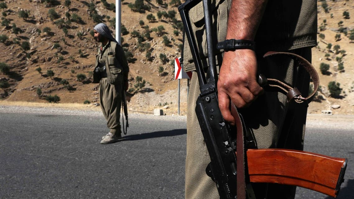 Members of the Kurdistan Workers' Party (PKK) carry rifles as they stand guard on a road in the Qandil Mountains, the PKK headquarters in northern Iraq. (File photo)