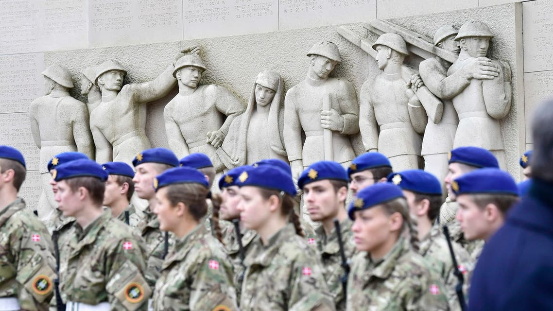 Soldiers are pictured during a wreath laying ceremony to mark the 100th anniversary of the end of World War I in Mindeparken in Aarhus, on November 11, 2018.