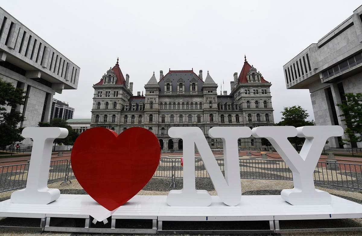 """A new promotional """"I Love NY"""" sign sits in the Empire State Plaza for installation in front of the New York state Capitol in Albany, New York. (AP)"""