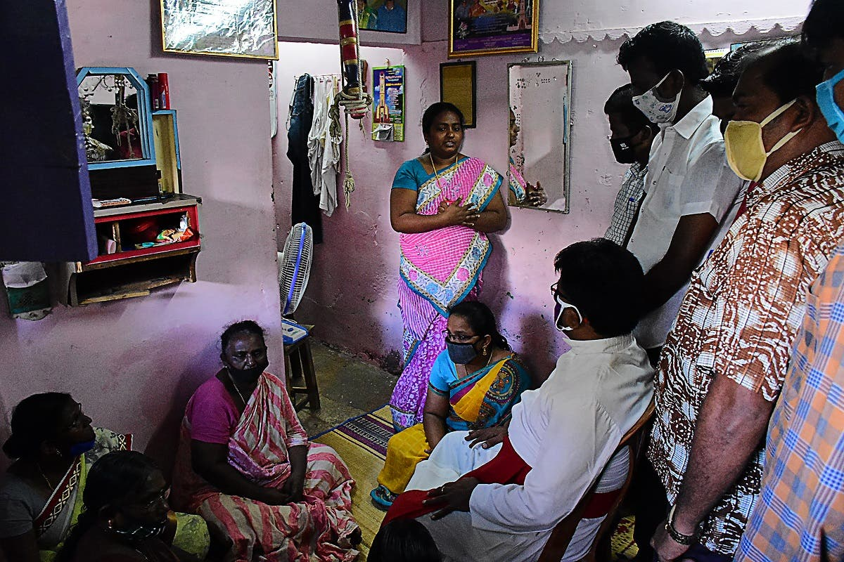 A church priest (C bottom) consoles family members of Jayaraj, 58, and son Bennicks Immanuel, 31, allegedly tortured at the hands of police in the Indian state of Tamil Nadu on June 28, 2020. (AFP)