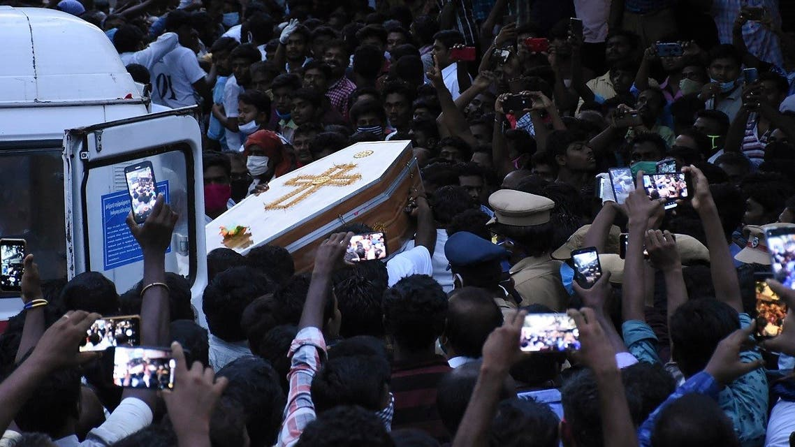 In this picture taken on June 26, 2020, residents gather as they carry the coffin of Jayaraj, 58, and son Bennicks Immanuel, 31, allegedly tortured at the hands of police in Sathankulam, Thoothukudi district in the Indian state of Tamil Nadu. (AFP)