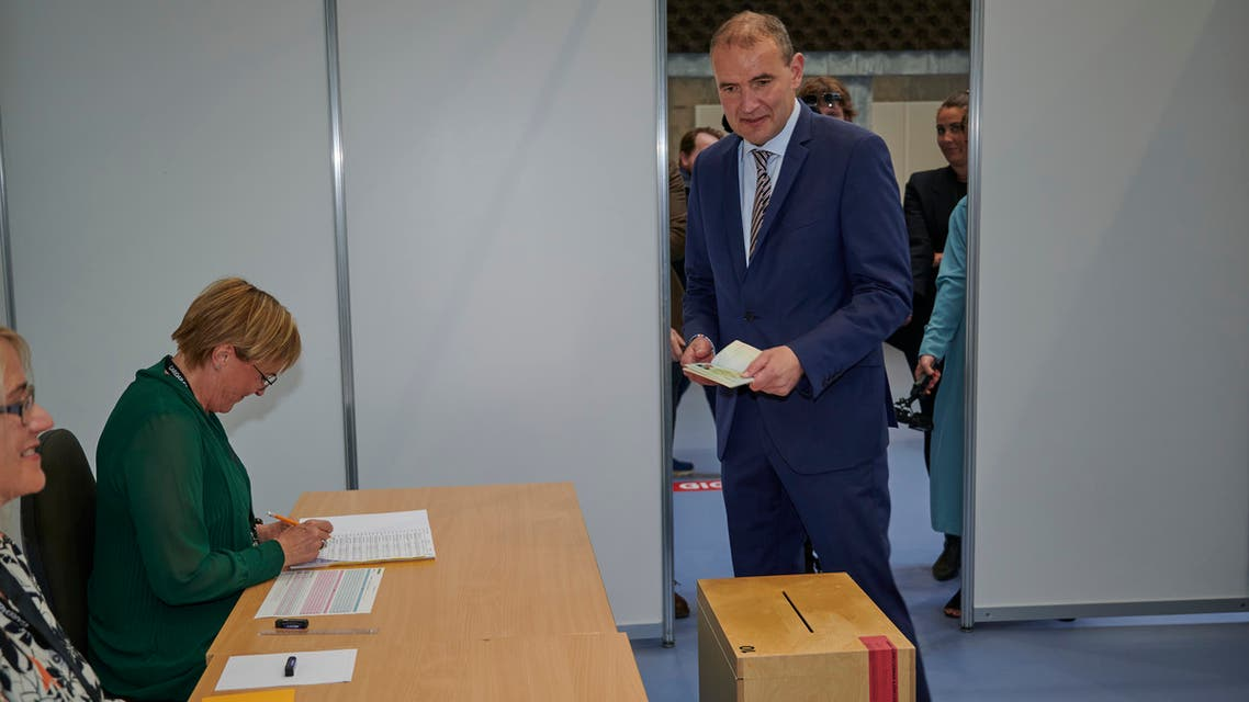 Sitting President of Iceland, Gudni Th Johannesson (L) arrives to cast his vote at the polling station 'Altanesskoli' in Gardabaer, Iceland on June 27, 2020.