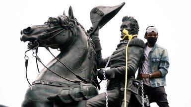 4 رجال حاولوا إسقاط تمثال بواشنطن يواجهون القضاء