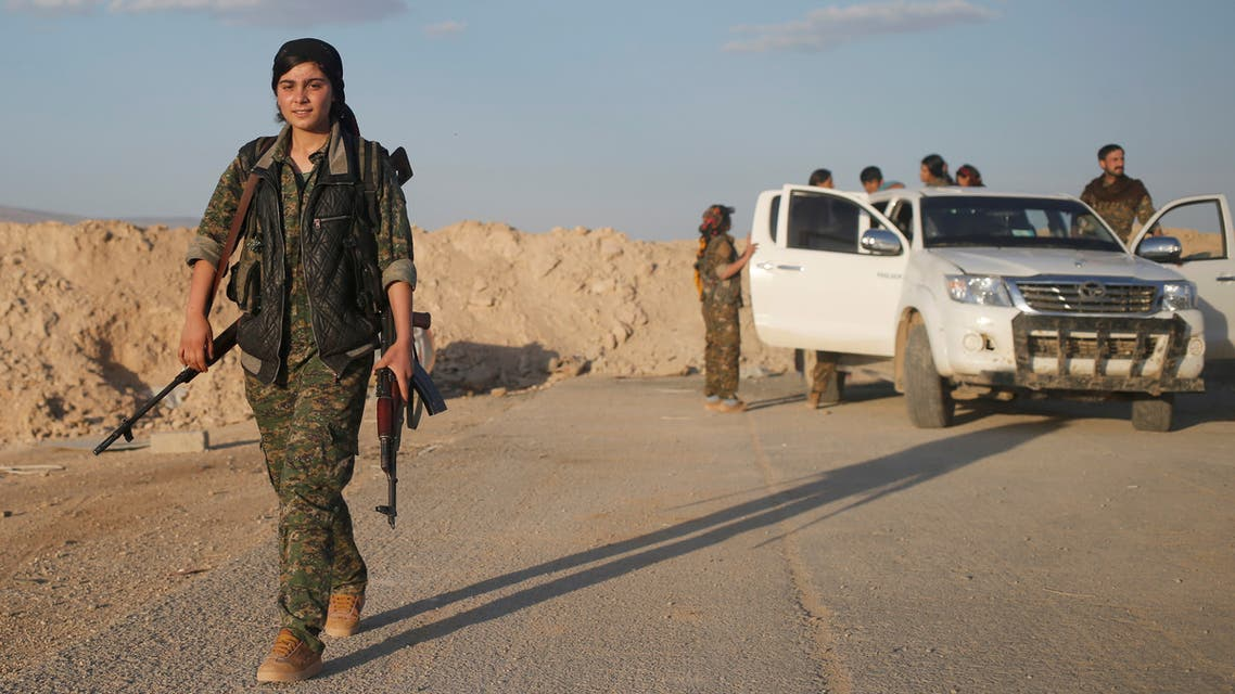 A female member of the Sinjar Resistance Units (YBS), a militia affiliated with the Kurdistan Workers' Party (PKK), carries a sniper and an AK-47 rifle in the village of Umm al-Dhiban, northern Iraq, April 29, 2016. They share little more than an enemy and struggle to communicate on the battlefield, but together two relatively obscure groups have opened up a new front against Islamic State militants in a remote corner of Iraq. The unlikely alliance between the Sinjar Resistance Units, an offshoot of a leftist Kurdish organisation, and Abdulkhaleq al-Jarba, a Arab tribal militia is a measure of the extent to which Islamic State has upended the regional order. Across Iraq and Syria, new groups have emerged where old powers have waned, competing to claim fragments of territory from Islamic State and complicating the outlook when they win. REUTERS/Goran Tomasevic SEARCH YBS TOMASEVIC FOR THIS STORY. SEARCH THE WIDER IMAGE FOR ALL STORIES