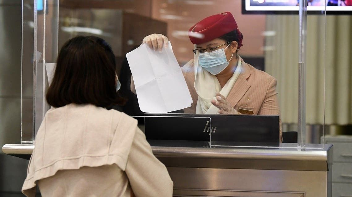 A passenger of an Emirates airlines flight departing to the Australian city of Sydney, checks in at Dubai International Airport. (File photo: AFP)