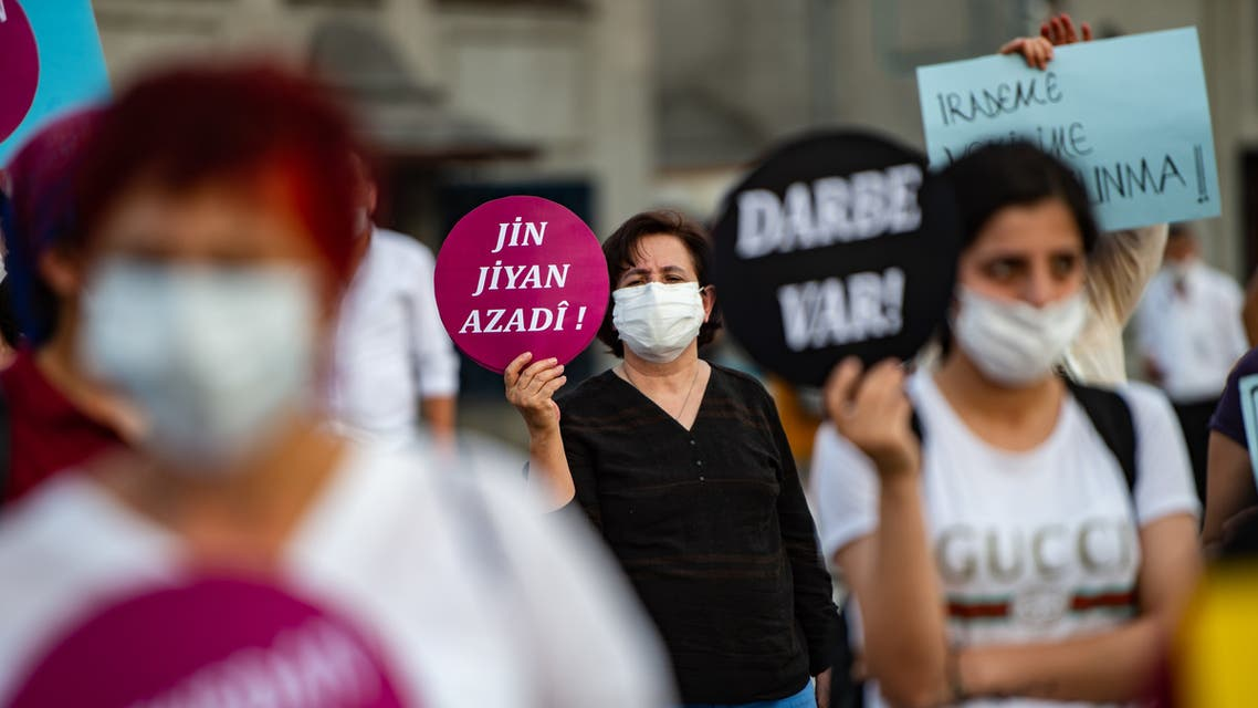 A woman hold placard reading '' Women, Life and Freedom '' during a protest against the detention of three opposition lawmakers, in Istanbul, Turkey, on June 6, 2020. Turkish police on June 4, 2020 detained three opposition lawmakers after the parliament stripped them of their jobs, triggering furious charges that President Recep Tayyip Erdogan's government is seeking to further consolidate authoritarian rule.