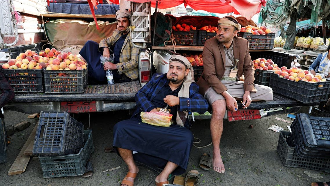 Fruit vendors chew qat, a mild stimulant, amid concerns of the spread of the coronavirus disease (COVID-19) at a fruit market in Sanaa, Yemen June 1, 2020. Picture taken June 1, 2020. REUTERS/Khaled Abdullah TPX IMAGES OF THE DAY