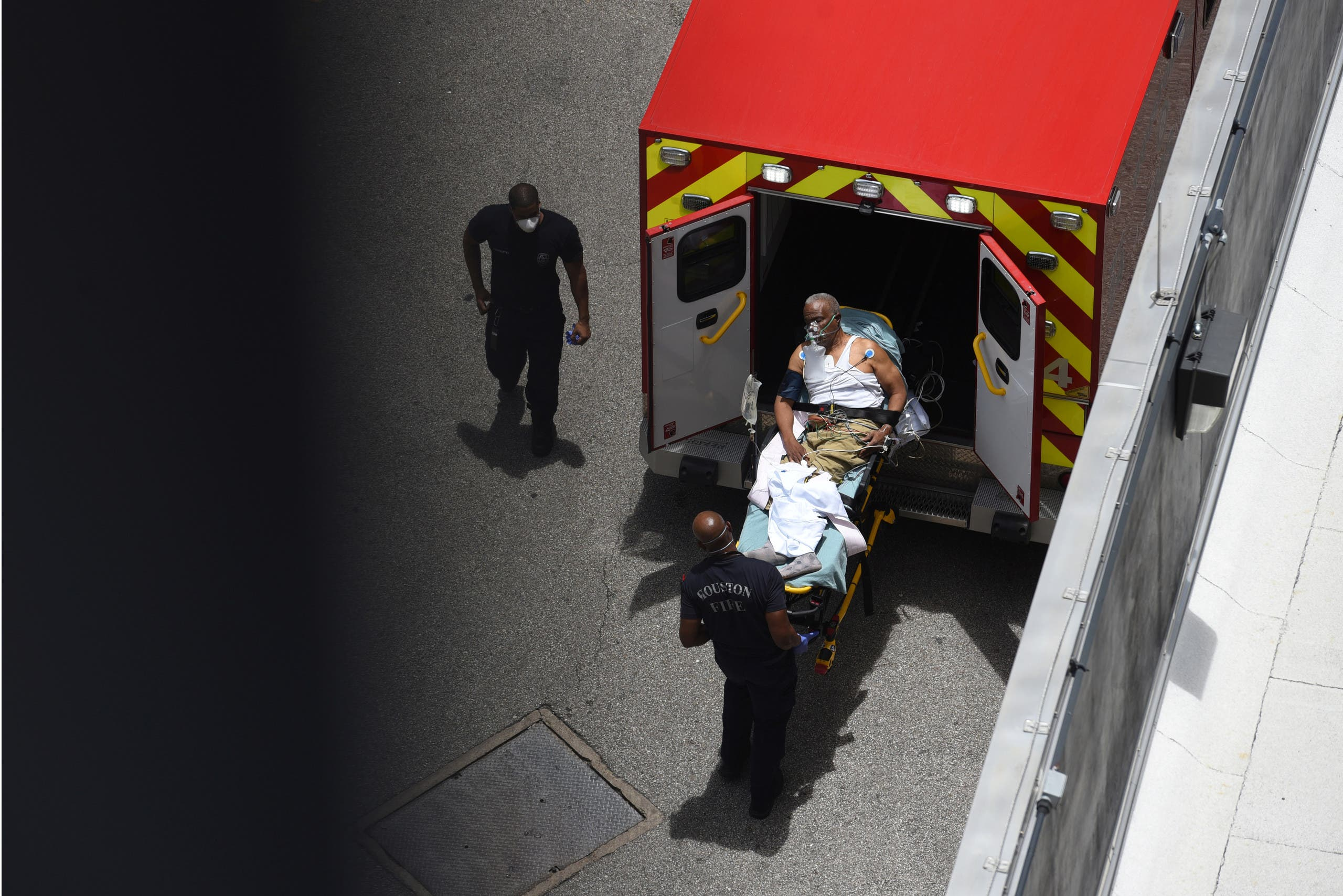 A man arrives at Houston Methodist Hospital emergency room on a stretcher amid a coronavirus disease (COVID-19) outbreak in Houston, Texas, US, June 28, 2020. (Reuters)
