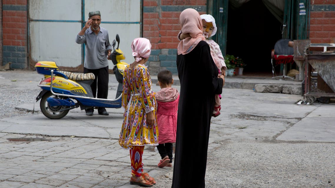 A Uighur woman wears a full length garment and headscarf in the city of Aksu in western China's Xinjiang province. (AP)