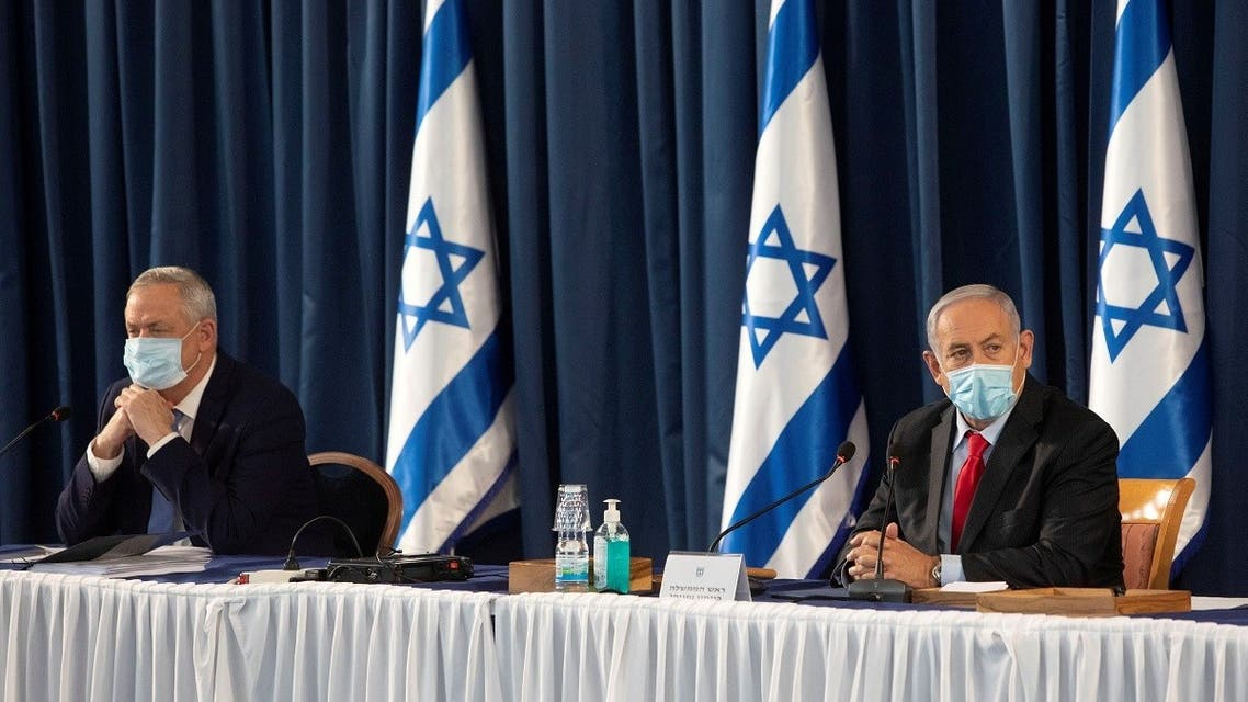 Israeli Prime Minister Benjamin Netanyahu and Israeli Defense Minister Benny Gantz attend the weekly cabinet meeting at the Ministry of Foreign Affairs in Jerusalem, June 14, 2020. (Reuters)