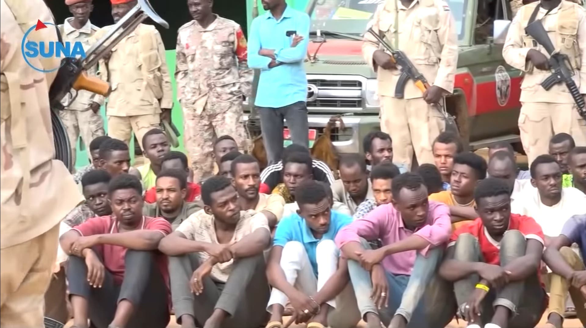 A screengrab of a video published by Sudan News Agency on June 29, 2020 showing some of the 122 fighters who were allegedly intending to serve as mercenaries in Libya's civil war . (Twitter/via @SUNA_AGENCY)