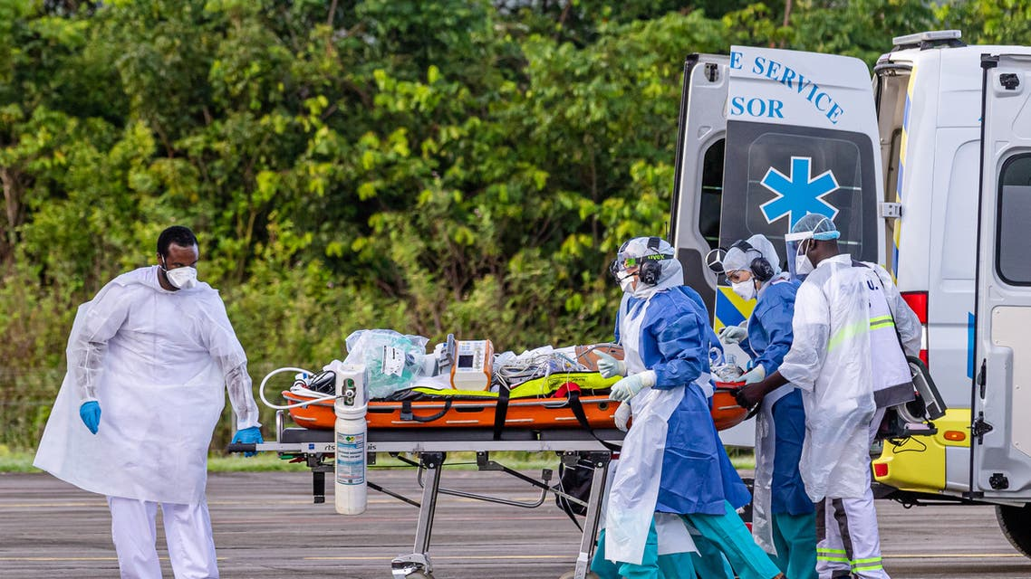 Medical staff carry a patient infected with the novel coronavirus (Covid-19) into an Airbus A400M at Guiana air-base 367 in Matoury, near Cayenne, in the French overseas department of Guiana, on June 28, 2020, to strengthen the medical evacuation capacities of patients to hospitals in the region, during the spread of the coronavirus.