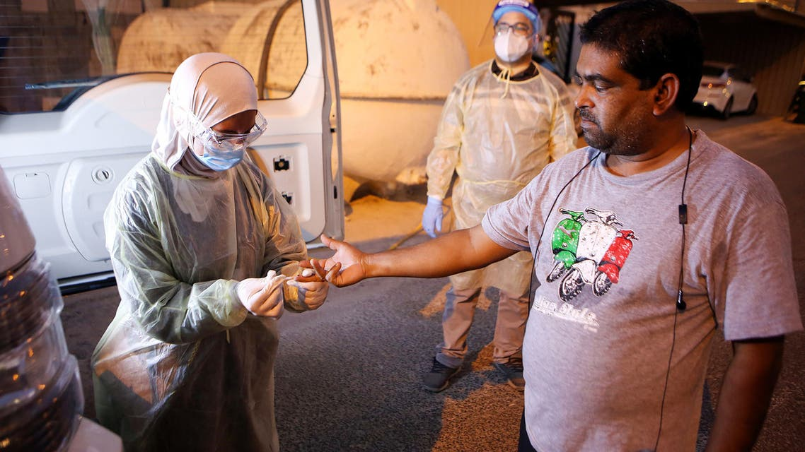 A Kuwaiti health ministry worker conducts a random test for the novel coronavirus (COVID-19) in Kuwait City on June 27, 2020.