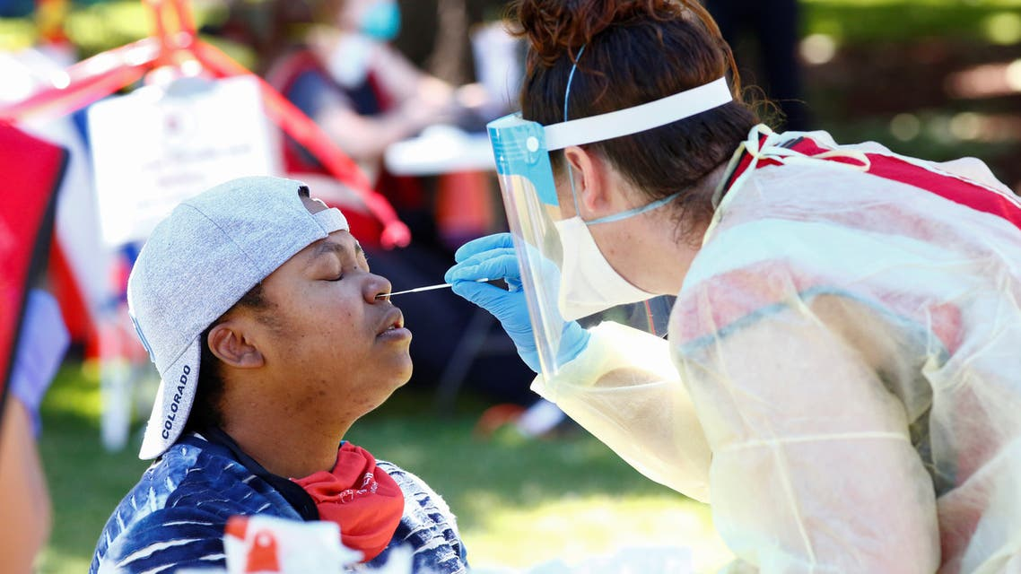 Dr. Genene Duran gets swabbed for a coronavirus disease (COVID-19) test at a testing site set up at an event to mark Juneteenth, which commemorates the end of slavery in Texas, two years after the 1863 Emancipation Proclamation freed slaves elsewhere in the United States, amid nationwide protests against racial inequality in Civic Center Park in Denver, Colorado, U.S., June 20, 2020. REUTERS/Kevin Mohatt