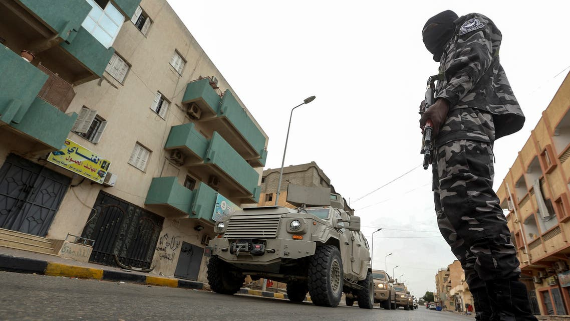 A member of security forces affiliated with the Libyan Government of National Accord (GNA)'s Interior Ministry stands as a security patrol advances in the town of Tarhuna, about 65 kilometres southeast of the capital Tripoli on June 11, 2020.
