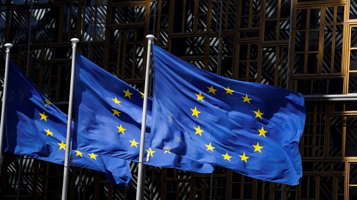 A picture taken on May 28 in Brussels shows the European Union flags fluttering in the aire outside the European Commission building in Brussels. (AFP)