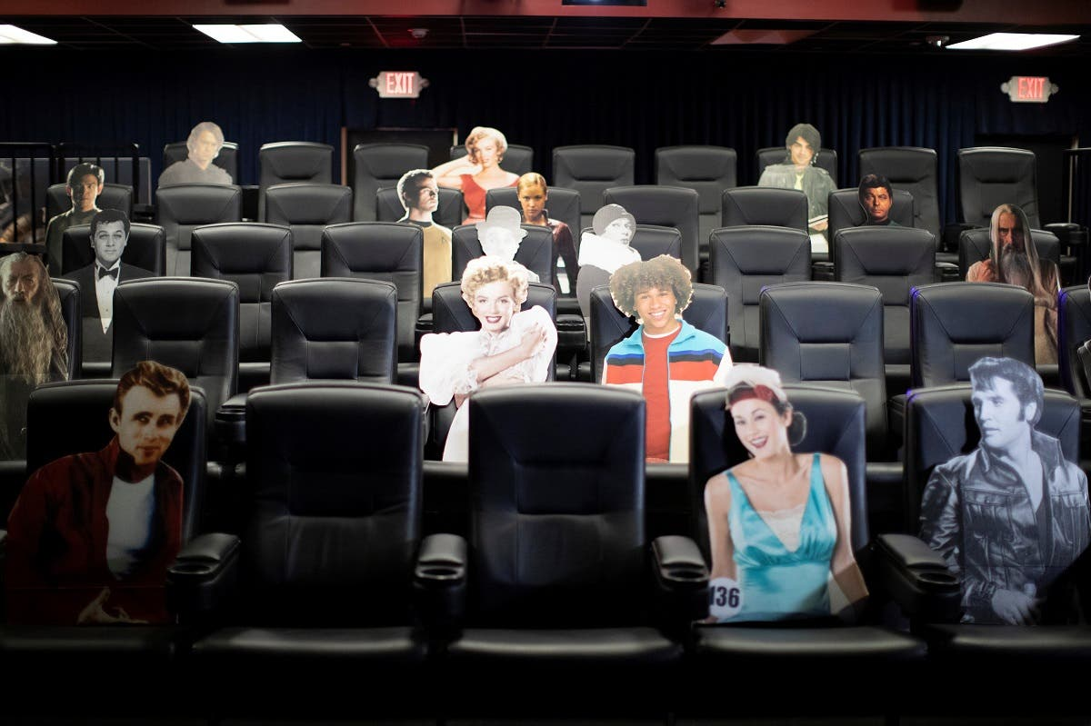 Seats are spaced by cardboards of movie characters aimed at social distancing ahead of the reopening of the Arena Cinelounge theatre during the coronavirus outbreak in Los Angeles, California, June 17, 2020. (Reuters)
