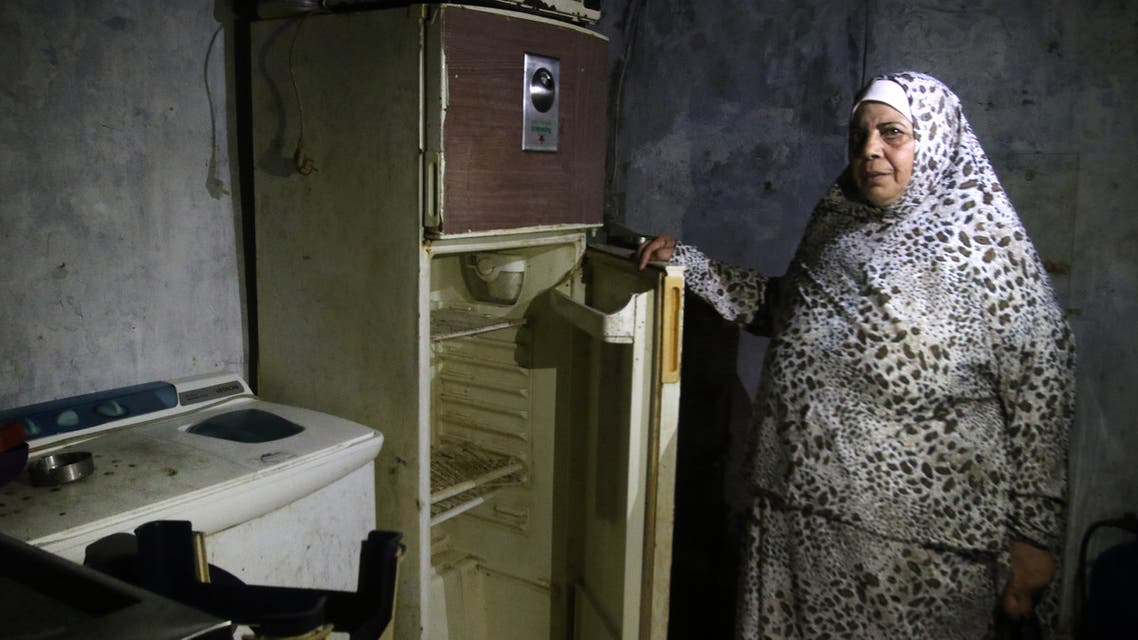 A Lebanese woman displays the content of her refrigerator at her apartment in the southern city of Sidon on June 16, 2020. (AFP)