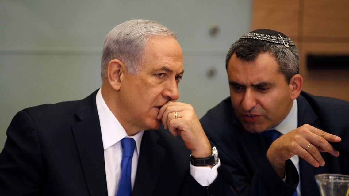 A file photo of Netanyahu (L) listens Zeev Elkin during a committee meeting at parliament in Jerusalem June 2, 2014. (Reuters)