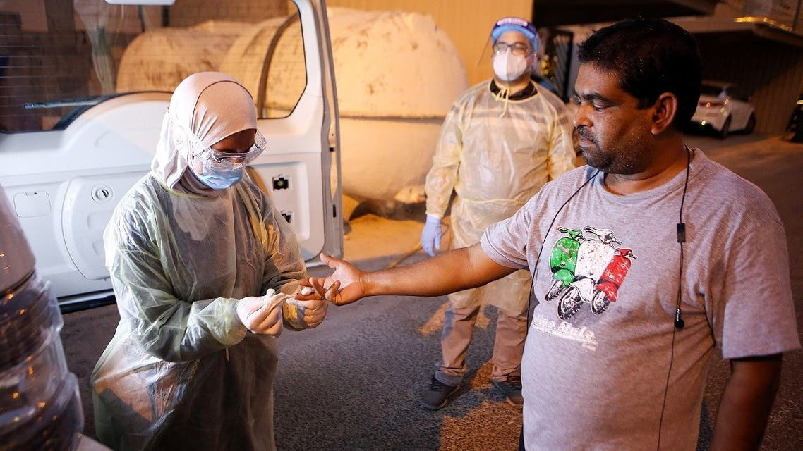 A Kuwaiti health ministry worker conducts a random test for the novel coronavirus (COVID-19) in Kuwait City on June 27, 2020. (AFP)