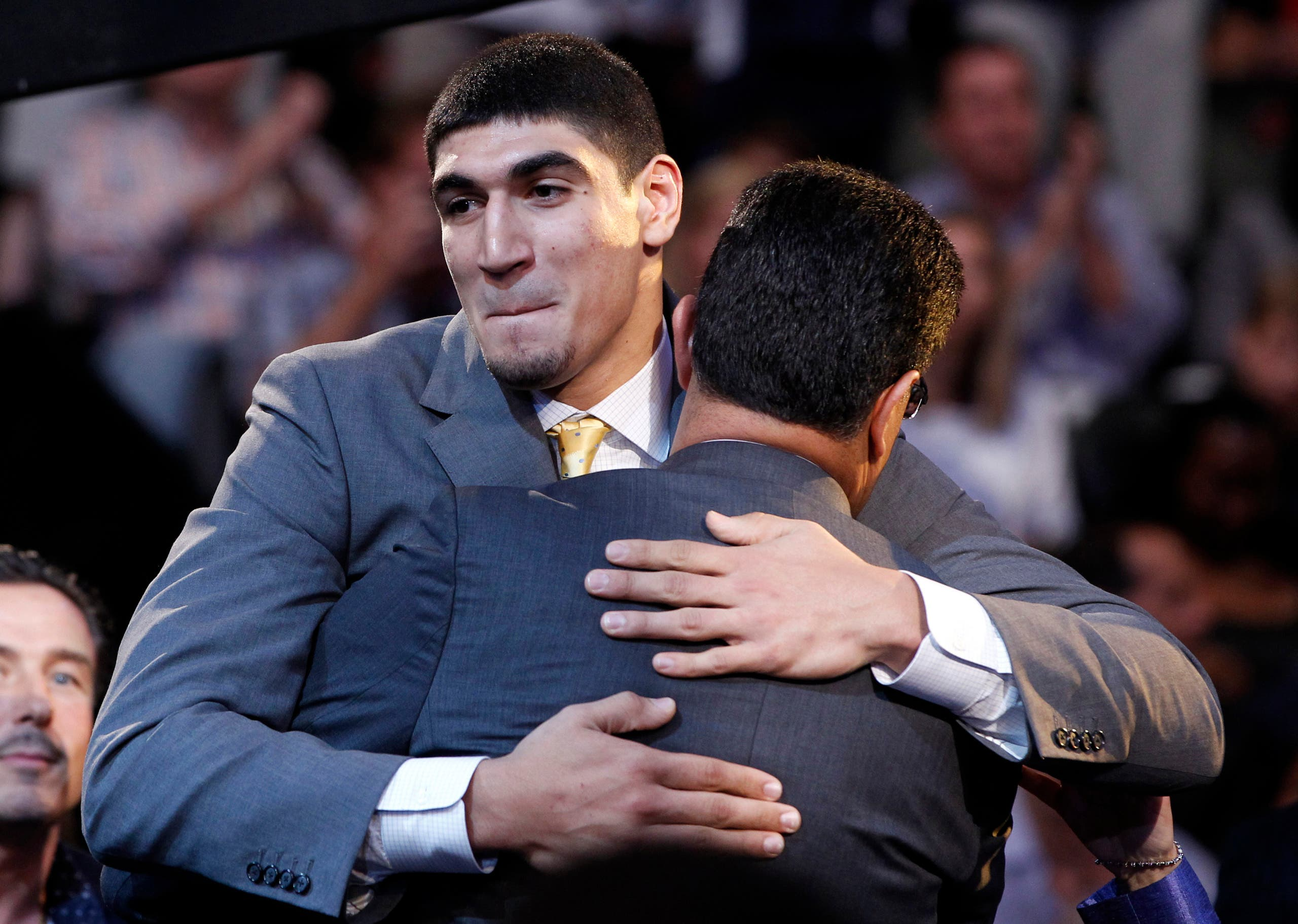 Enes Kanter hugs his father after being selected in the 2011 NBA Draft in Newark, New Jersey on June 23, 2011. (Reuters)