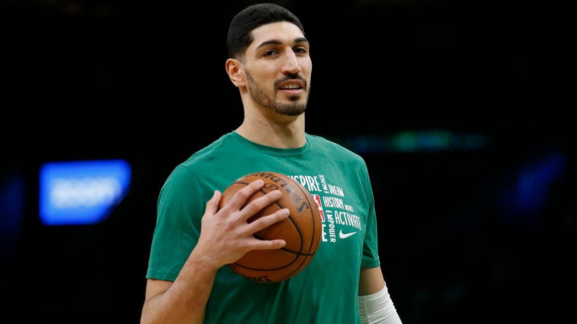 Boston Celtics center Enes Kanter holds a ball during warmups on Feb. 7, 2020 in Boston. (AP)