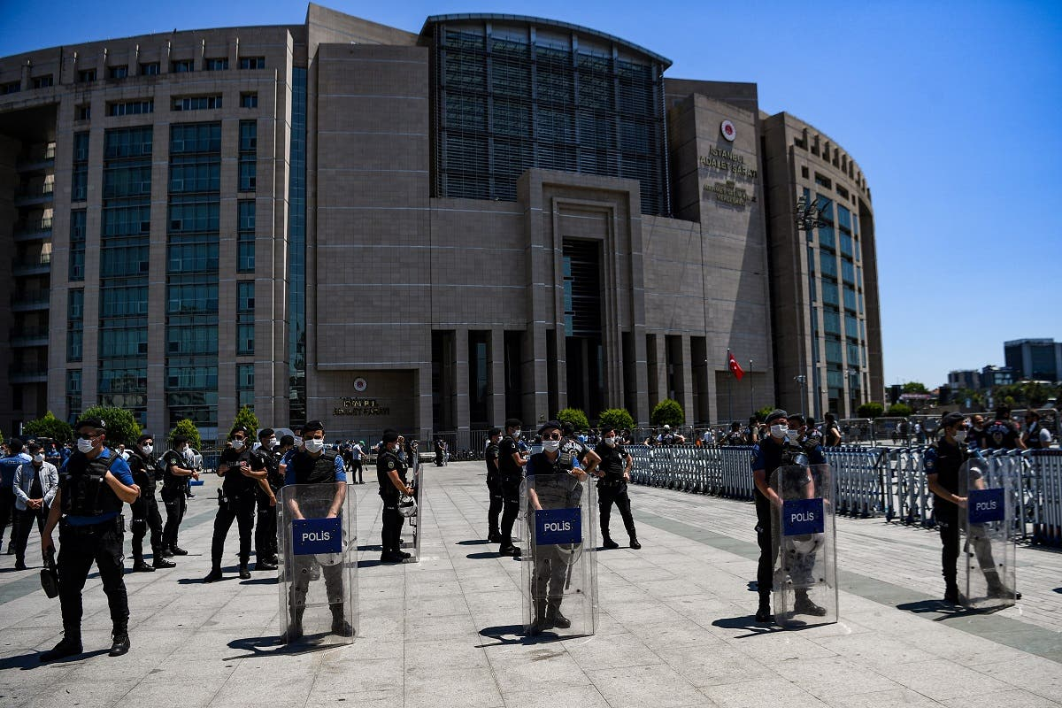 Turkish riot police officers stand guard as lawyers demonstrate in front of Istanbul's courthouse, on June 30, 2020, during a demonstration against a draft law which aims to change the existing structure of bar associations. (AFP)
