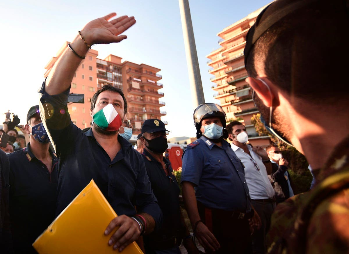 Far-right League (Lega) party leader Matteo Salvini (C) gestures in front of a block of flats where 43 positive cases of coronavirus have been identified, and where tensions flared over a cluster of coronavirus cases among Bulgarian farm workers, fueling tension with locals in Mondragone, north of Naples, on June 29, 2020. (AFP)