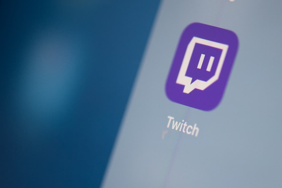 This file photo taken on July 24, 2019 shows the US live streaming video platform Twitch logo application on the screen of a tablet. (AFP)