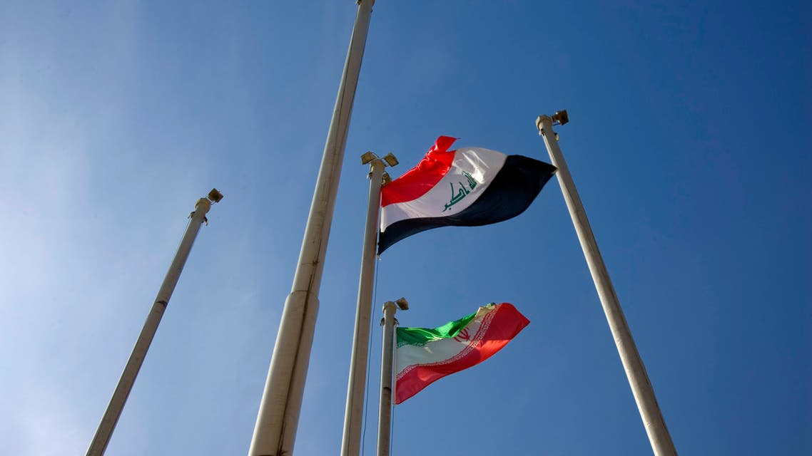 Iraq (top) and Iran flags flutter in the wind during a farewell ceremony for Iraq's Prime Minister Nuri al-Maliki at the International Mehrabad airport in Tehran January 4, 2009. (Reuters)