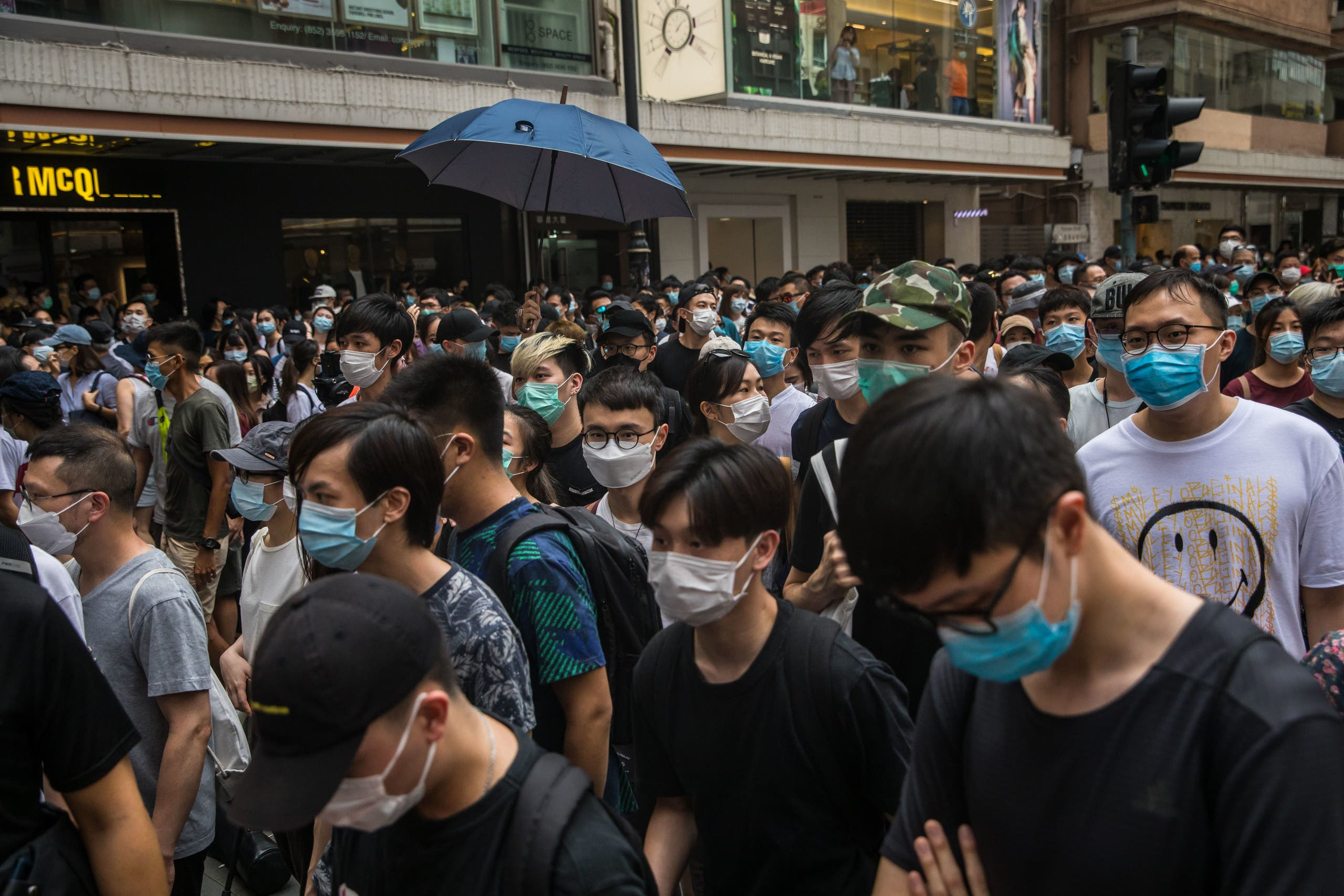 Protests march on a street during a rally against a new national security law in Hong Kong on July 1, 2020, on the 23rd anniversary of the city's handover from Britain to China. (AFP)