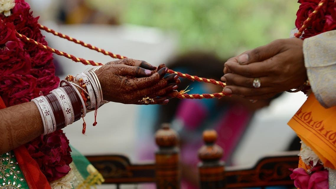 An Indian visually impaired bridal couple participate in Hindu rituals during a mass marriage at the Andh Kanya Praksh Gruh in Ahmedabad on January 19, 2014. (AFP)