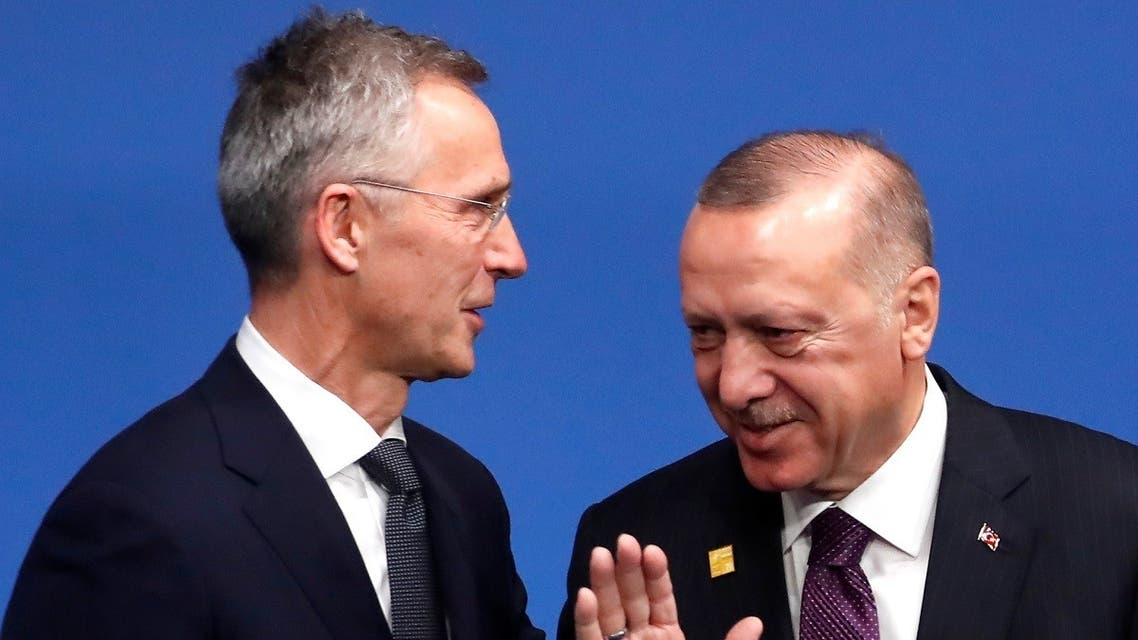 A file photo of NATO chief Jens Stoltenberg (L) and Turkey's President Erdogan (R) during the NATO summit in London, December 4, 2019. (AFP)