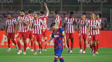 أتلتيكو يوقف برشلونة ويقرب ريال مدريد من اللقب
