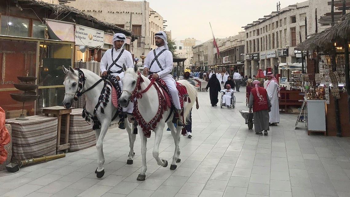 Men in traditional costume ride on horses at souq Waqif, following the outbreak of coronavirus, in Doha, Qatar March 12, 2020. (Reuters)