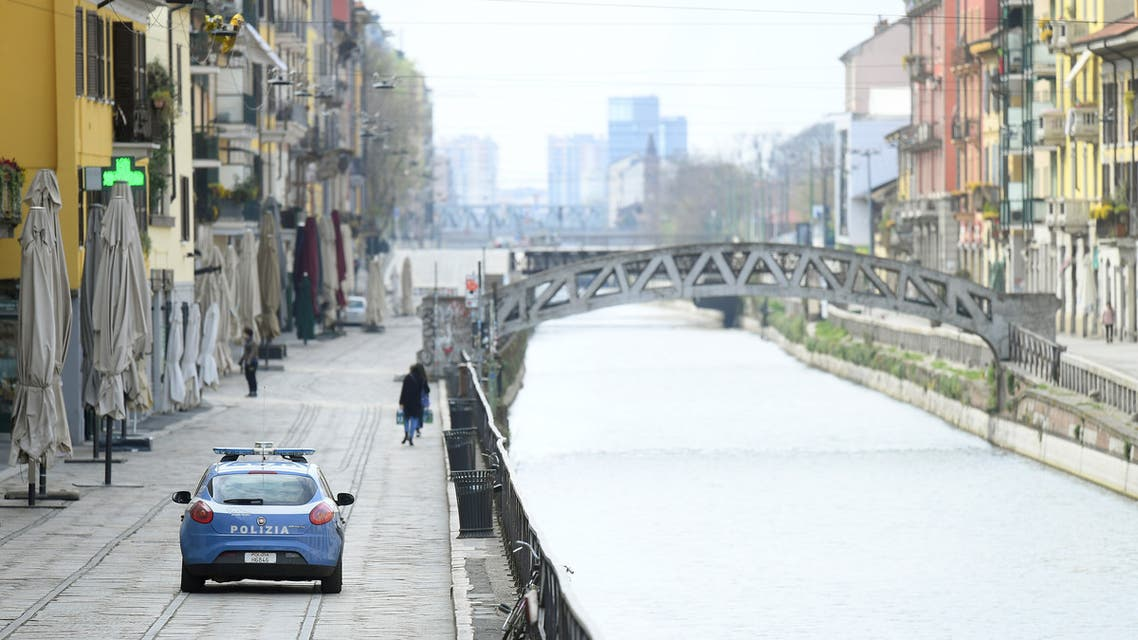 An Italian police car patrols during a lockdown against the spread of coronavirus disease (COVID-19) in Milan, Italy March 22, 2020. (Reuters)