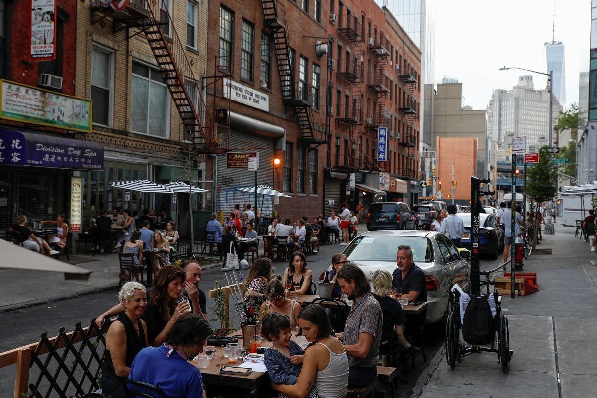 People eat outside during part of the phase 2 reopening in New York City, June 27, 2020. (Reuters)