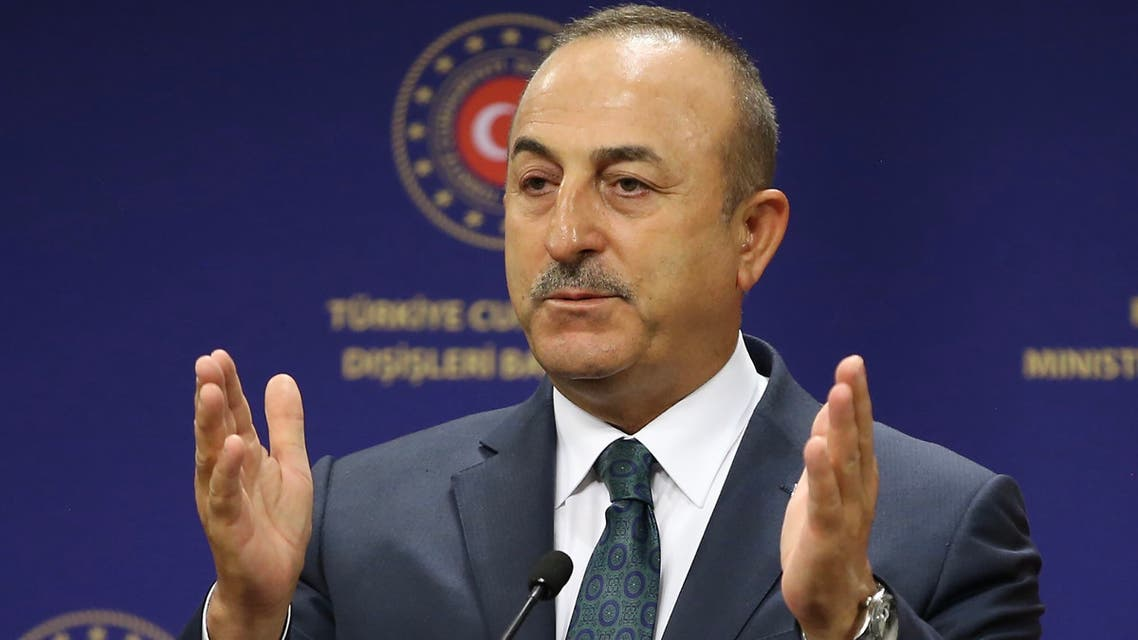 A handout image made available by the Turkish Foreign Ministry Press Office on June 19, 2020, shows the Turkish Foreign Minister Mevlut Cavusoglu speaking during a joint press conference with his Italian counterpart following their meeting in Ankara.