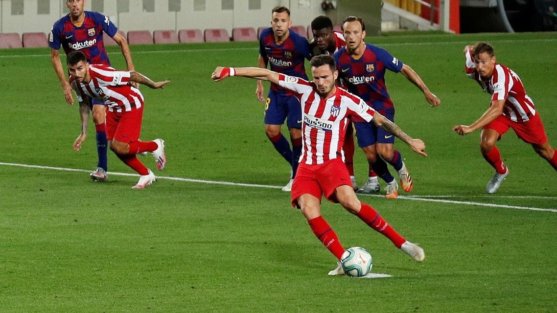 Atletico Madrid's Saul Niguez scores their second goal from the penalty spot, as play resumes behind closed doors following the outbreak of the coronavirus disease. (Reuters)