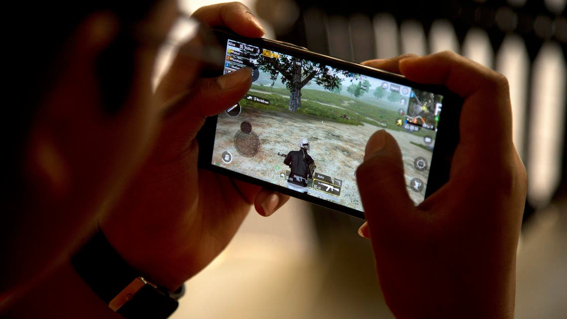 An Indian boy plays an online game PUBG on his mobile phone sitting outside his house in Hyderabad, India, Friday, April 5, 2019. (AP)