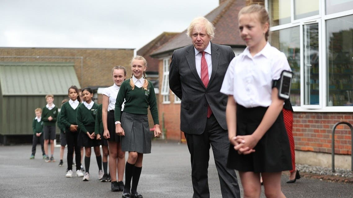 Britain's Prime Minister Boris Johnson joins a socially distanced lesson during a visit to Bovingdon Primary School in Bovingdon, Hemel Hempstead, Hertfordshire. (AFP)