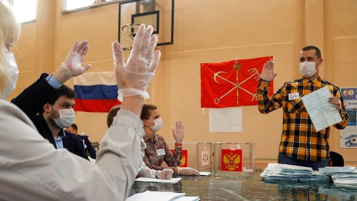 Members of a local electoral commission discuss if a ballot is valid as they count, in Saint Petersburg, Russia, July 1, 2020. (Reuters)